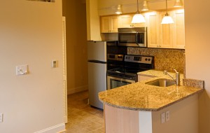 Each unit features a gourmet kitchen with stainless steel appiances.